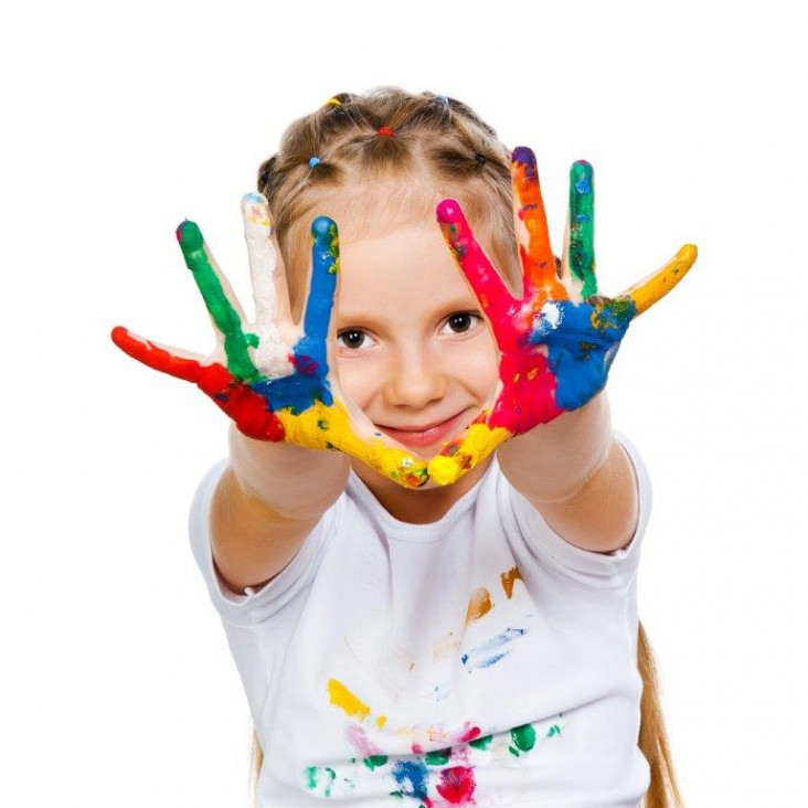 kid with paint on fingers